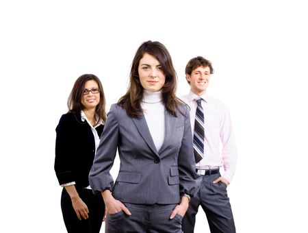 Team of three young business people standing and posing for portrait, smiling businesswoman in front. photo