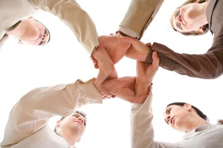 Small group of business people joining hands, low angle view.  Stock Photo - 2460007