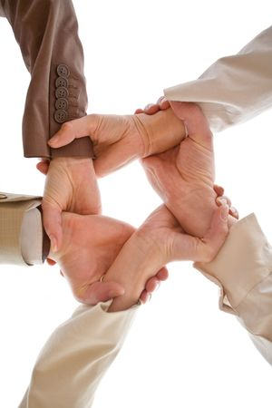 angle view: Small group of business people joining hands, low angle view.
