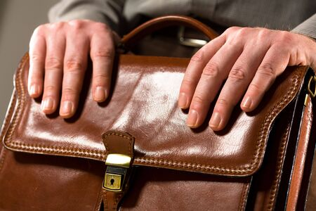 Business man holding elegant brown leather briefcase. Stock Photo - 2481847