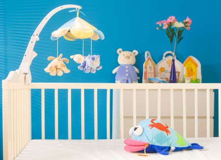 hanging toy: Crib and soft baby toys at childrens room. Toys are officially property released. LANG_EVOIMAGES