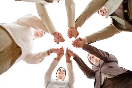Five business people forming a circle and holding hands, smiling, low angle view.  Stock Photo - 3199991
