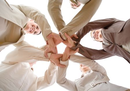 Small group of business people joining hands, low angle view. Stock Photo - 3199990