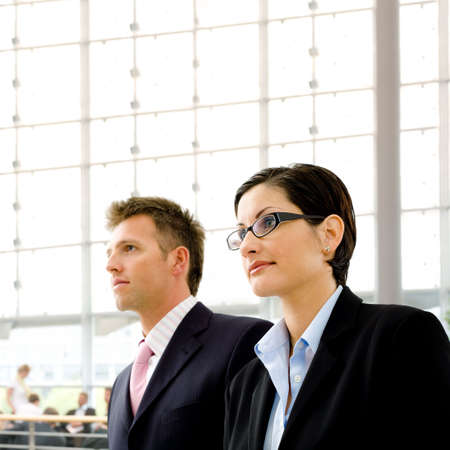 Young business people standing indoor in a  modern office building. Stock Photo - 3200006