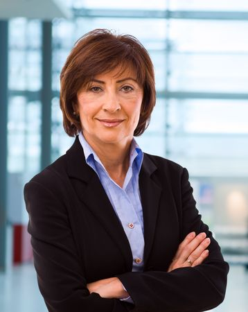 Portrait of senior businesswoman at office lobby. Stock Photo - 3774938
