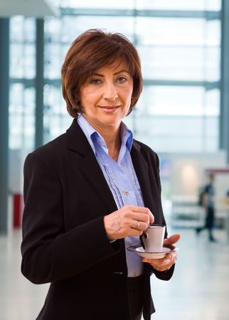 Portrait of senior businesswoman at office lobby. photo