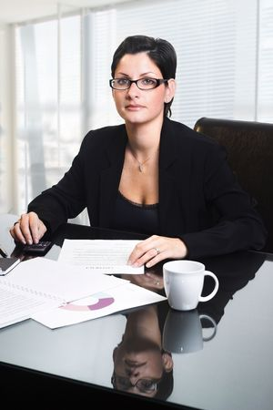 Business woman is reading documents. Stock Photo - 3785404