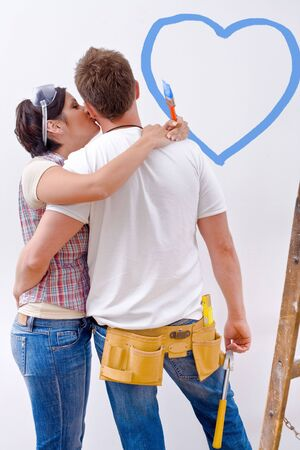 Young couple improving new home. Stock Photo