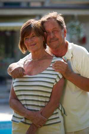 Portrait of happy active senior couple posing outdoor in front of home. Stock Photo - 3823633