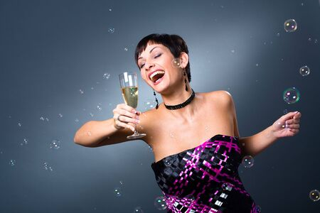 Happy young women with a glass of champagne. Stock Photo - 3823599