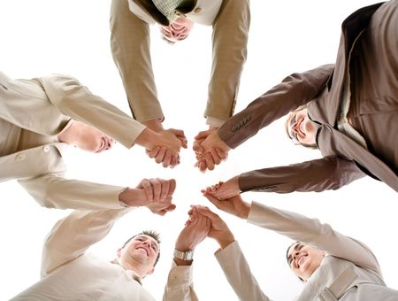 Five business people forming a circle and holding hands, smiling, low angle view.  Stock Photo - 3823788