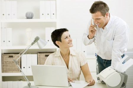 Happy couple working at home office running small business.