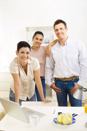 Happy team of office workers running small business, smiling. photo