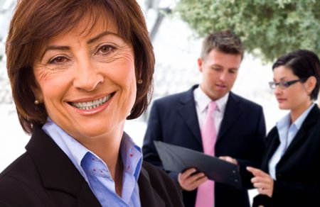 Senior businesswoman with working business team in background.  Stock Photo - 3823806