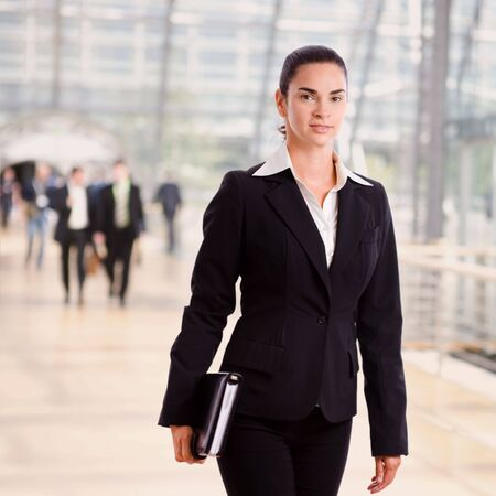 Successful happy businesswoman walking at office hall. Stock Photo - 3850856