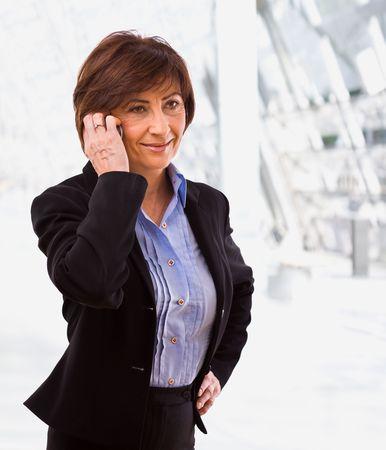 Senior businesswoman calling on mobile phone. photo