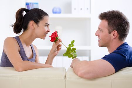 adult valentine: Romantic man giving red rose to woman - Valentines Day. Stock Photo