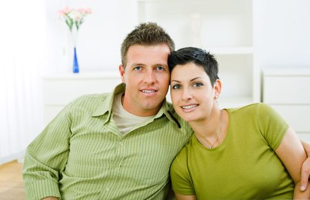 Happy love couple cuddling at home, smiling. Stock Photo - 3861570