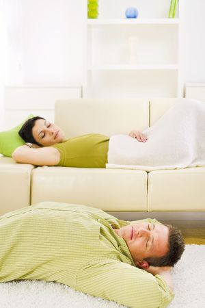 Couple sleeping at home on sofa and on floor. Stock Photo - 3861563