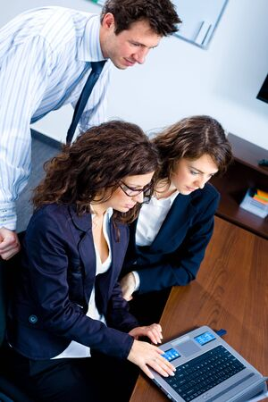 Young businesspeople working together in business team on laptop computer in meeting room at office. Stock Photo