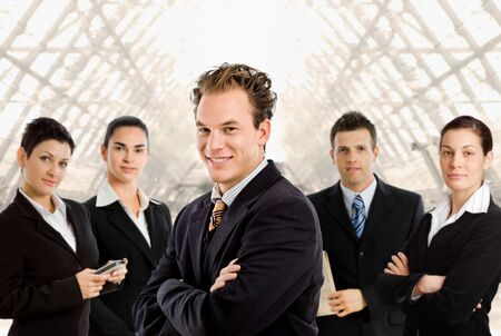 Happy business people team up for a group portrait.  Stock Photo