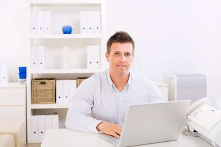 Business man working on laptop computer at home. Stock Photo - 3884145