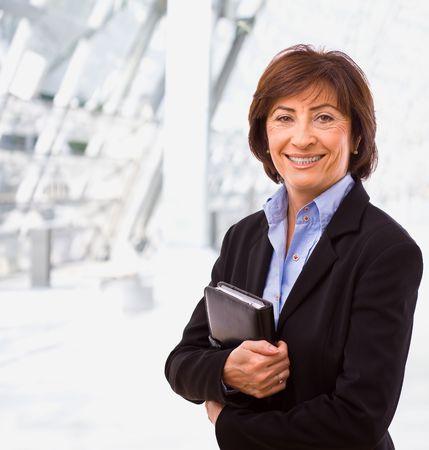businesswear: Portrait of senior businesswoman at office lobby.