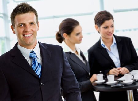 Happy successful business team working smiling at office. Stock Photo - 3884325