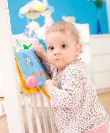 Portrait of a baby girl ( 1 year old ) at home, looking at camera. Stock Photo - 3889280