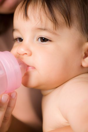 Baby drinking from feeding bottle Stock Photo - 3889291