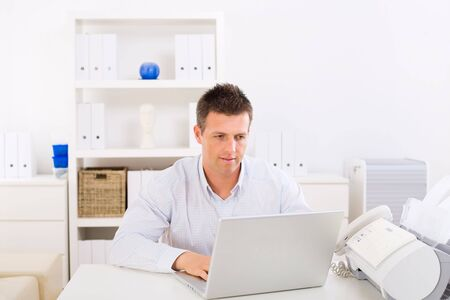 Business man working on laptop computer at home. Stock Photo - 3916144