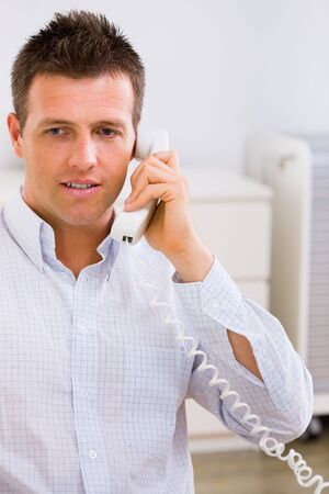 Business man working at home, calling on phone. Stock Photo - 3916203
