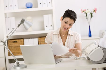 Business woman working on laptop computer at home. photo