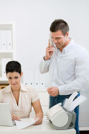 outworking: Happy couple working at home office running small business.