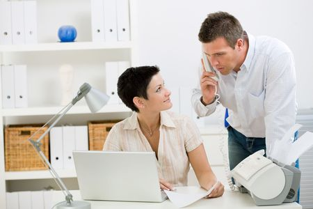 Happy couple working at home office running small business. photo