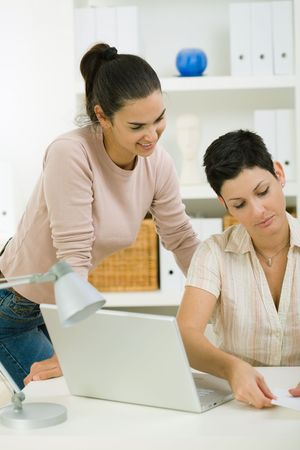 Happy businesswomen woring in team at office. photo