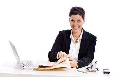 Businesswoman reading financial newspaper, white background. photo
