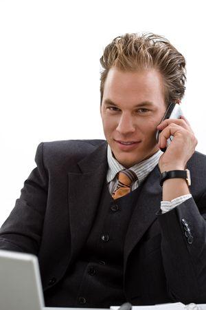 Businessman using laptop computer, mobile phone, white background Stock Photo - 3916189
