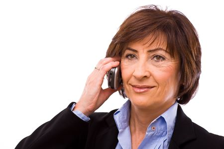 Senior businesswoman calling on mobile phone isolated on white background. Stock Photo - 3916191