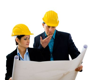 Young architects looking at blueprint. Isolated on white background. Stock Photo - 3916125