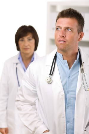 Portrait of medical doctors male and female at office. photo