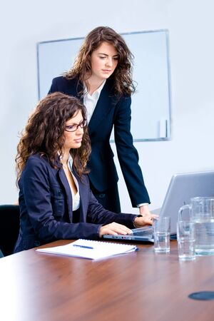 Young businesswomen working together in business team on laptop computer in meeting room at office. photo