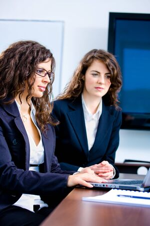 Young businesswomen working together in business team on laptop computer in meeting room at office. Stock Photo - 4105337