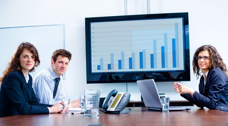 business consulting: Happy business people having meeting at modern office, smiling. Stock Photo