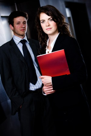 Corporate businesspeople businessman and businesswoman standing side by side posing for team portrait at office corridor. Stock Photo - 4083277