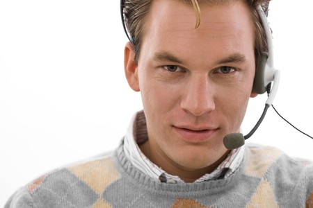 Smiling male customer service operator in headset, white background. photo
