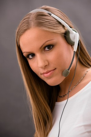 Young female customer service representative in headset. Stock Photo - 4089963