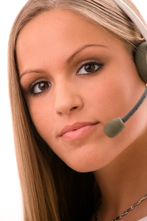 customer service representative: Young female customer service representative in headset, white background. Stock Photo