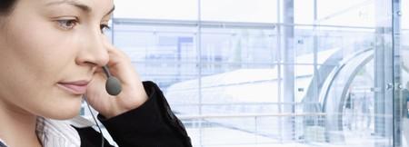 Happy customer service representative talking on phone in headset. Stock Photo - 4090343