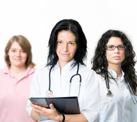Happy female medical team doctors and nurse posing for portrait, smiling, isolated on white. Stock Photo - 4089972